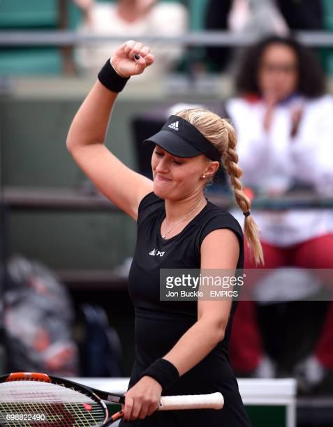 Kristina Mladenovic celebrates winning her 1st round women's singles match against Eugenie Bouchard on day three of the French Open at Roland Garros...