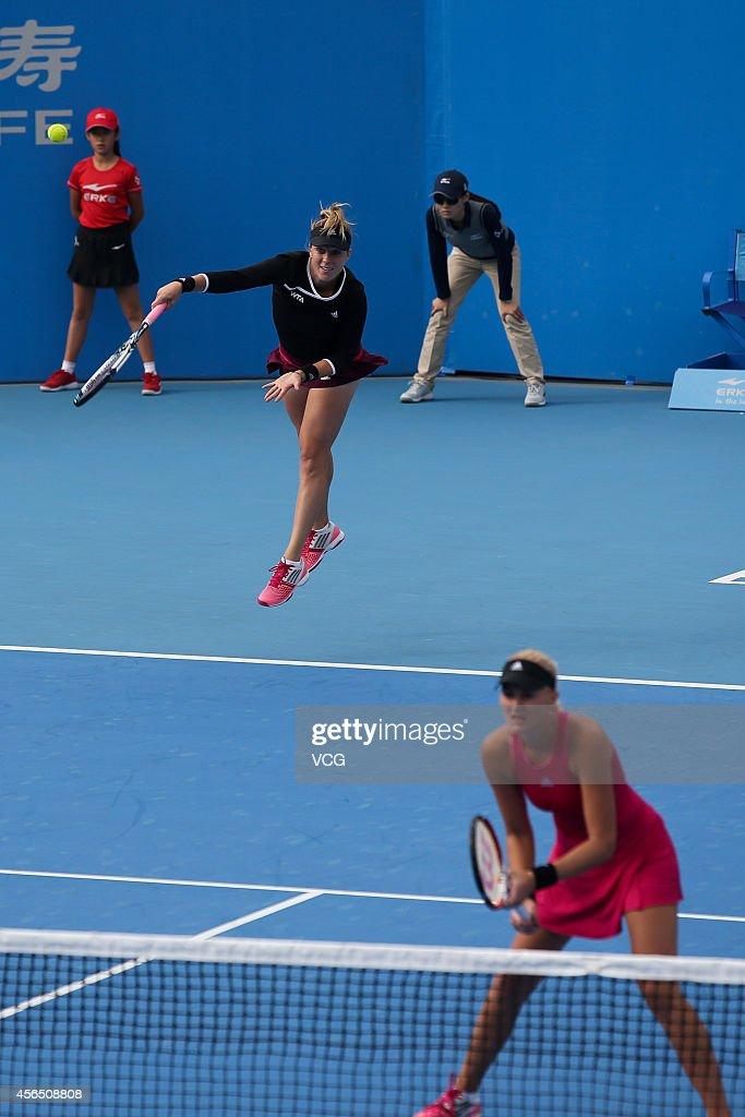 Kristina Mladenovic of France and Anastasia Pavlyuchenkova of Russia compete with Martina Hingis of Switzerland and Flavia Pennetta of Italy at...