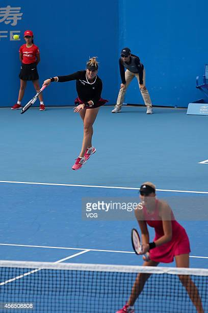 Kristina Mladenovic of France and Anastasia Pavlyuchenkova of Russia compete with Martina Hingis of Switzerland and Flavia Pennetta of Italy at...