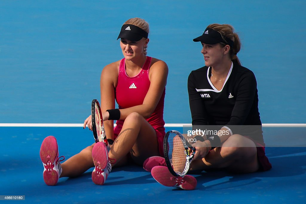 Kristina Mladenovic of France (L) and Anastasia Pavlyuchenkova of Russia, dissatisfied with the referee's decision carry out a protest by sitting down on the court during their match against Martina Hingis of Switzerland and Flavia Pennetta of Italy at National Tennis Centre in day 6 of 2014 China Open on October 2, 2014 in Beijing, China.