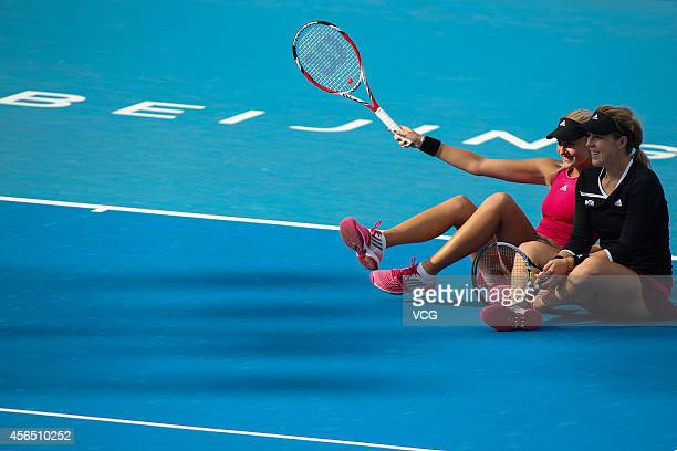Kristina Mladenovic of France and Anastasia Pavlyuchenkova of Russia dissatisfied with the referee's decision carry out a protest by sitting down on...