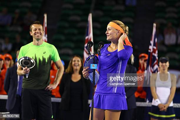 Kristina Mladenovic of France and Daniel Nestor of Canada hold the runner up plate after losing their final mixed doubles match against Martina...