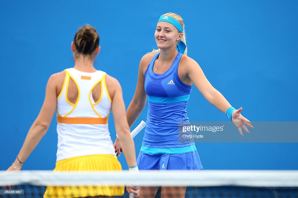 Kristina Mladenovic of France and Flavia Pennetta of Italy in action in their second round doubles match against Madison Keys of the United States and Alison Riske of the United States during day six of the 2014 Australian Open at Melbourne Park on January 18, 2014 in Melbourne, Australia.