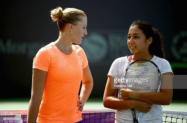 Kristina Mladenovic of France and Zarina Diyas of Kazakhstan attends the Kids Day during day two of the WTA Dubai Duty Free Tennis Championship at...