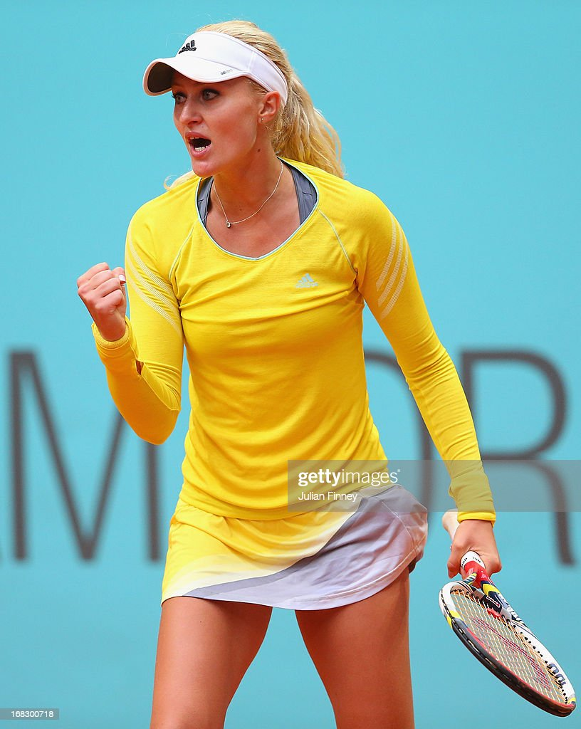 Kristina Mladenovic of France celebrates a point against Maria Kirilenko of Russia during day five of the Mutua Madrid Open tennis tournament at the Caja Magica on May 8, 2013 in Madrid, Spain.