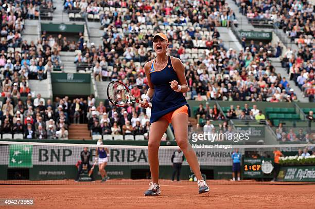 Kristina Mladenovic of France celebrates a point during her women's singles match against Alison Riske of the United States on day five of the French...