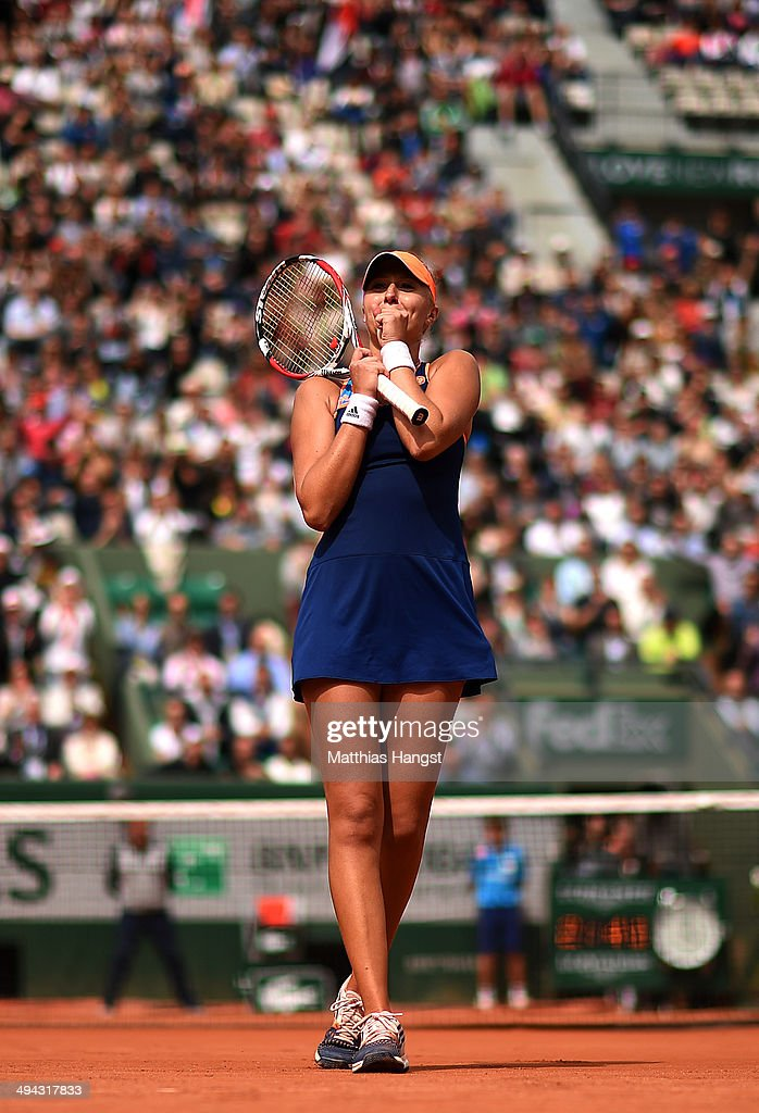 Kristina Mladenovic of France celebrates victory during her women's singles match against Alison Riske of the United States on day five of the French Open at Roland Garros on May 29, 2014 in Paris, France.
