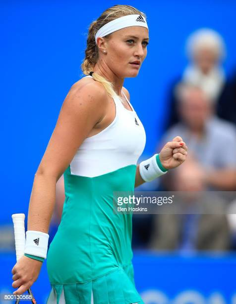 Kristina Mladenovic of France celebrates winning a point during the quarter final match against Petra Kvitova of The Czech Republic on day five of...