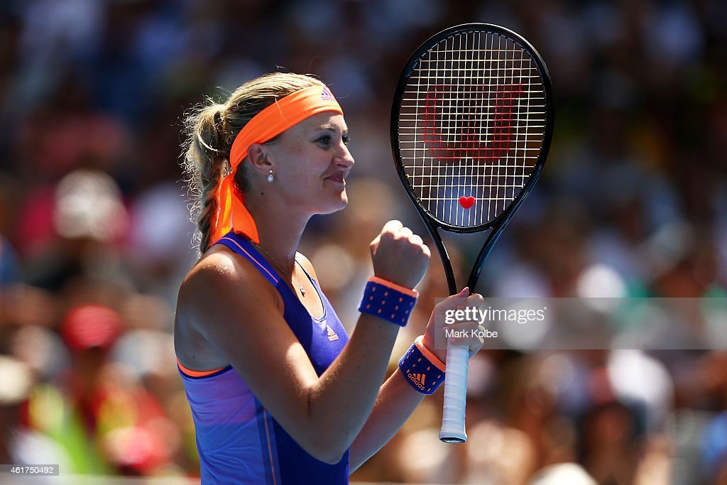 <a gi-track='captionPersonalityLinkClicked' href=/galleries/search?phrase=Kristina+Mladenovic&family=editorial&specificpeople=4835181 ng-click='$event.stopPropagation()'>Kristina Mladenovic</a> of France celebrates winning in her first round match against Sabine Lisicki of Germany during day one of the 2015 Australian Open at Melbourne Park on January 19, 2015 in Melbourne, Australia.