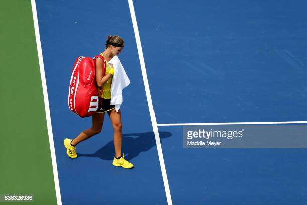 Kristina Mladenovic of France exits the court after being defeated by Timea Babos of Hungary during Day 4 of the Connecticut Open at Connecticut...