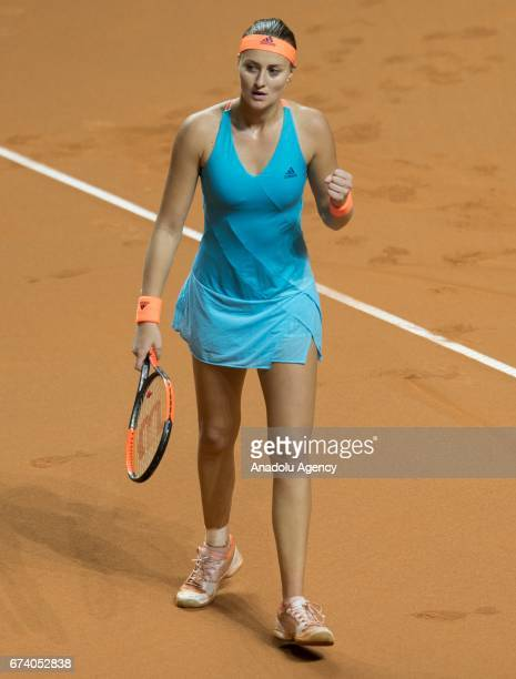 Kristina Mladenovic of France gestures as she compete against Angelique Kerber of Germany during the Porsche Tennis Grand Prix at Porsche Arena in...