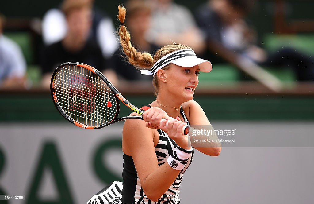 <a gi-track='captionPersonalityLinkClicked' href=/galleries/search?phrase=Kristina+Mladenovic&family=editorial&specificpeople=4835181 ng-click='$event.stopPropagation()'>Kristina Mladenovic</a> of France hits a backhand during the Ladies Singles second round match against Timea Babos of Hungary on day five of the 2016 French Open at Roland Garros on May 26, 2016 in Paris, France.