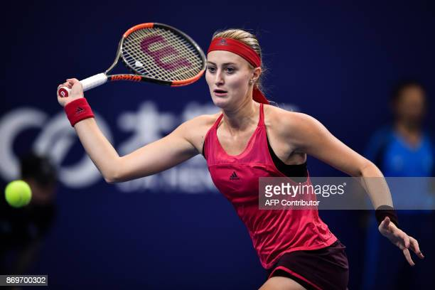 Kristina Mladenovic of France hits a return against Julia Goerges of Germany during their women's singles match at the Zhuhai Elite Trophy tennis...