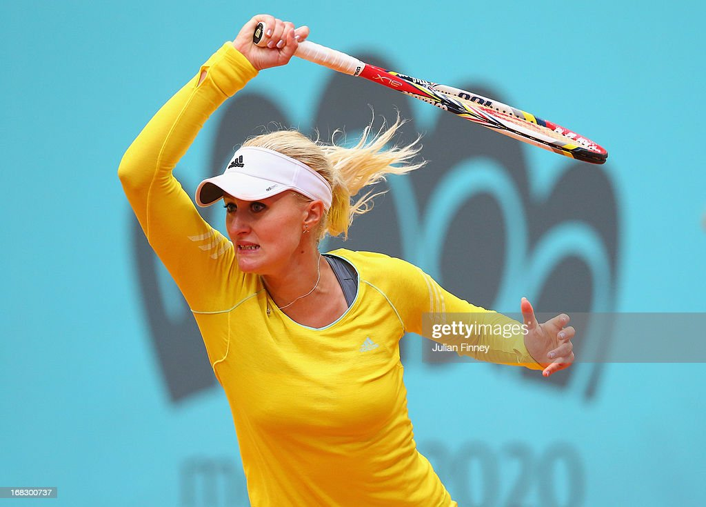 Kristina Mladenovic of France in action against Maria Kirilenko of Russia during day five of the Mutua Madrid Open tennis tournament at the Caja Magica on May 8, 2013 in Madrid, Spain.