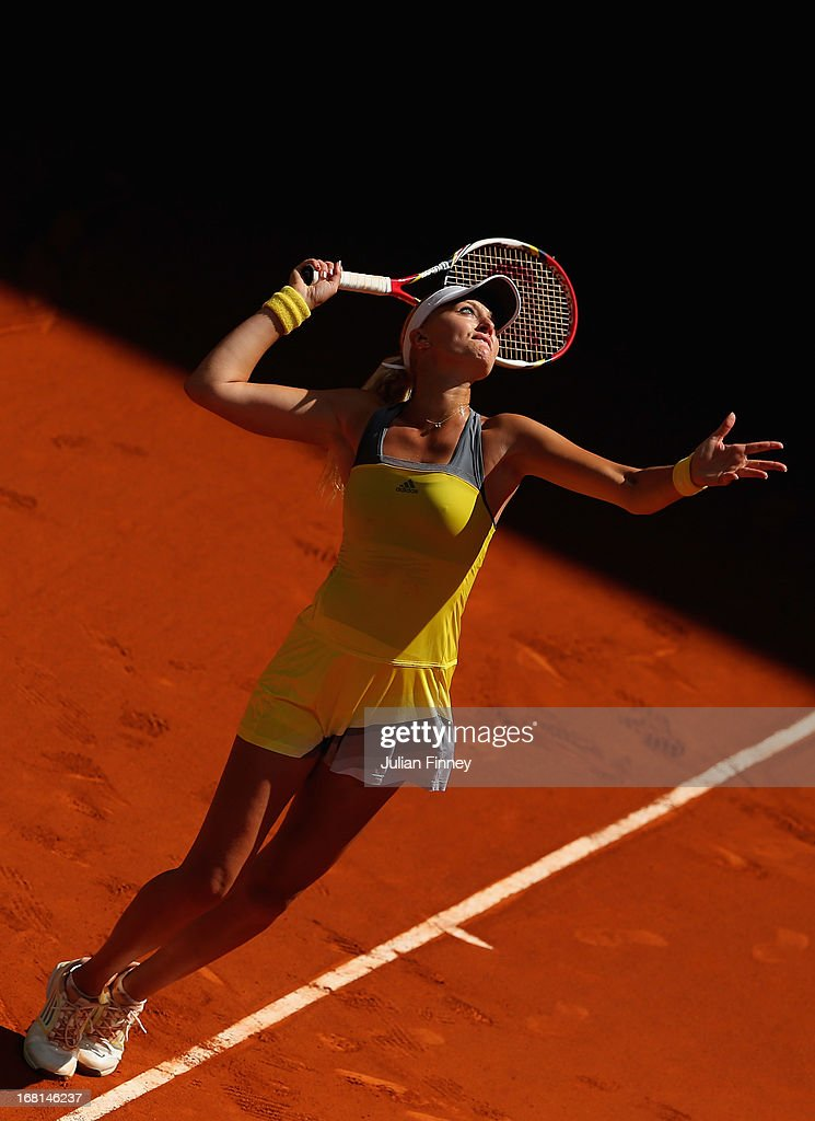 <a gi-track='captionPersonalityLinkClicked' href=/galleries/search?phrase=Kristina+Mladenovic&family=editorial&specificpeople=4835181 ng-click='$event.stopPropagation()'>Kristina Mladenovic</a> of France in action against Silvia Soler-Espinosa of Spain during day three of the Mutua Madrid Open tennis tournament at the Caja Magica on May 6, 2013 in Madrid, Spain.
