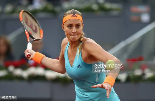 Kristina Mladenovic of France in action against Svetlana Kuznetsova of Russia in the semi finals during day seven of the Mutua Madrid Open tennis at...