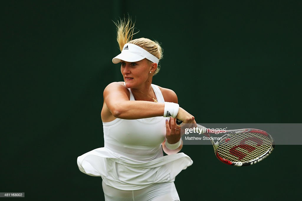 <a gi-track='captionPersonalityLinkClicked' href=/galleries/search?phrase=Kristina+Mladenovic&family=editorial&specificpeople=4835181 ng-click='$event.stopPropagation()'>Kristina Mladenovic</a> of France in action during her Ladies' Singles first round match against Zarina Diyas of Kazakhstan on day two of the Wimbledon Lawn Tennis Championships at the All England Lawn Tennis and Croquet Club at Wimbledon on June 24, 2014 in London, England.