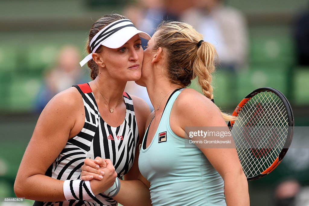 <a gi-track='captionPersonalityLinkClicked' href=/galleries/search?phrase=Kristina+Mladenovic&family=editorial&specificpeople=4835181 ng-click='$event.stopPropagation()'>Kristina Mladenovic</a> (L) of France is congratulated by <a gi-track='captionPersonalityLinkClicked' href=/galleries/search?phrase=Timea+Babos&family=editorial&specificpeople=5891501 ng-click='$event.stopPropagation()'>Timea Babos</a> of Hungary following her victory during the Ladies Singles second round match on day five of the 2016 French Open at Roland Garros on May 26, 2016 in Paris, France.