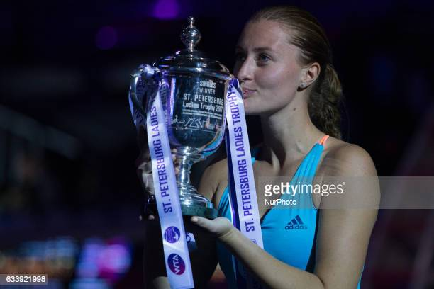 Kristina Mladenovic of France kisses her trophy after winning the St Petersburg Ladies Trophy ATP tennis tournament final match in St Petersburg...