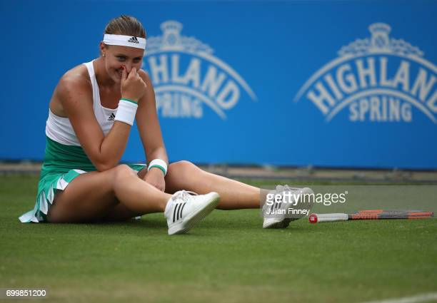 Kristina Mladenovic of France laughs after taking a fall in her match against Shuai Zhang of China during day four of the Aegon Classic at Edgbaston...