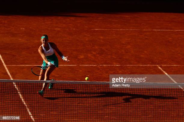 Kristina Mladenovic of France partner of Svetlana Kuznetsova of Russia plays a forehand during the ladies doubles match against Jana Capelova of...