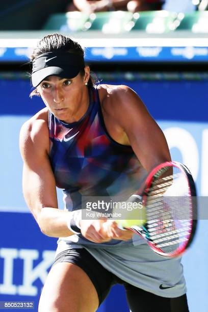 Kristina Mladenovic of France plays a backhand against Kurumi Nara of Japan during day four of the Toray Pan Pacific Open Tennis At Ariake Coliseum...