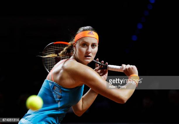 Kristina Mladenovic of France plays a backhand during her match against Angelique Kerber of Germany during the Porsche Tennis Grand Prix at Porsche...