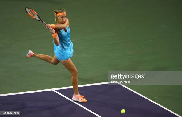 Kristina Mladenovic of France plays a backhand during her straight sets defeat by Elena Vesnina of Russia in their semi final match during day twelve...