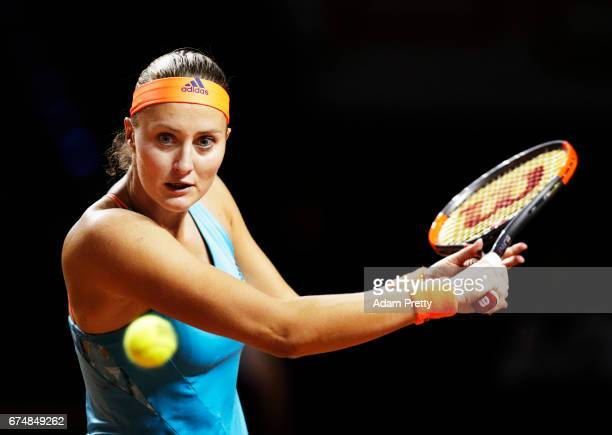 Kristina Mladenovic of France plays a backhand in her match against Maria Sharapova of Russia during the Porsche Tennis Grand Prix at Porsche Arena...