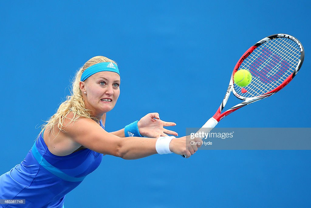 Kristina Mladenovic of France plays a backhand in her second round doubles match with Flavia Pennetta of Italy against Madison Keys of the United States and Alison Riske of the United States during day six of the 2014 Australian Open at Melbourne Park on January 18, 2014 in Melbourne, Australia.