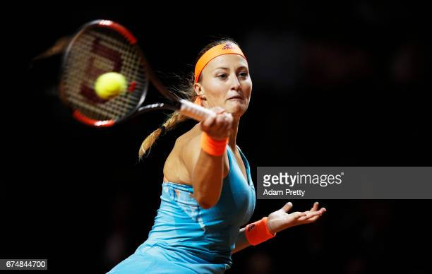 Kristina Mladenovic of France plays a forehand in her match against Maria Sharapova of Russia during the Porsche Tennis Grand Prix at Porsche Arena...