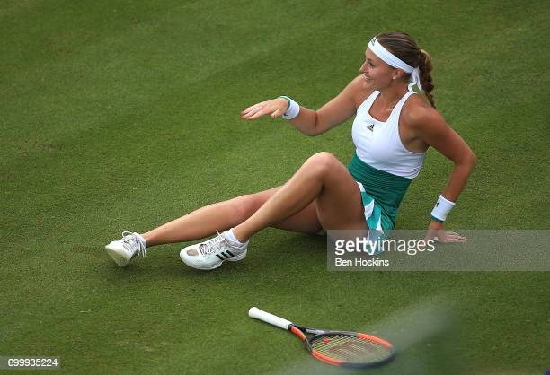 Kristina Mladenovic of France reacts after slipping during the second round match against Shuai Zhang of China on day four of The Aegon Classic...