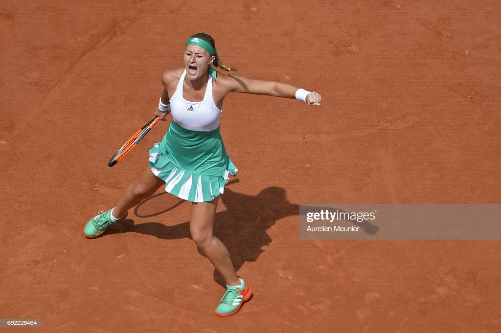 Kristina Mladenovic of France reacts during her Women's single match against Garbine Muguruza of Spain on day eight of the 2017 French Open at Roland Garros on June 04, 2017 in Paris, France.