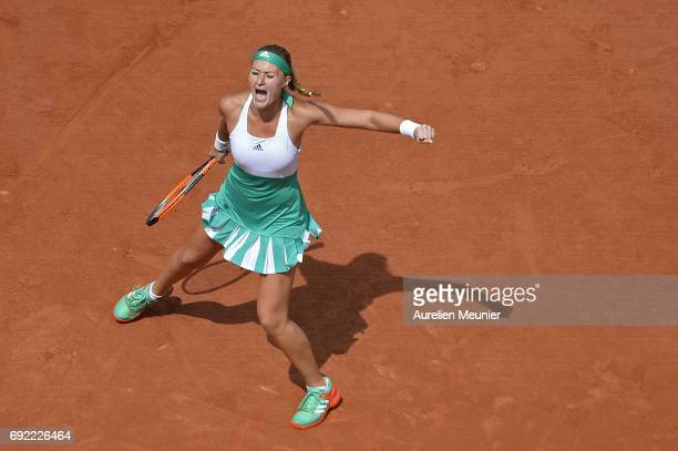 Kristina Mladenovic of France reacts during her Women's single match against Garbine Muguruza of Spain on day eight of the 2017 French Open at Roland...