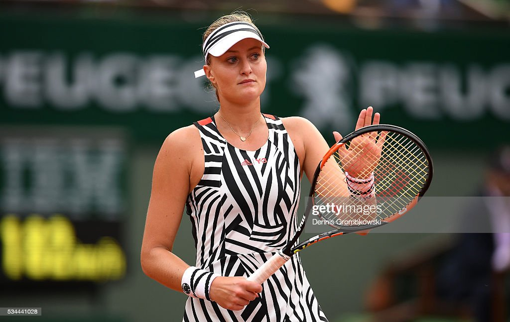 <a gi-track='captionPersonalityLinkClicked' href=/galleries/search?phrase=Kristina+Mladenovic&family=editorial&specificpeople=4835181 ng-click='$event.stopPropagation()'>Kristina Mladenovic</a> of France reacts during the Ladies Singles second round match against Timea Babos of Hungary on day five of the 2016 French Open at Roland Garros on May 26, 2016 in Paris, France.
