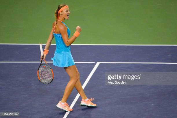 Kristina Mladenovic of France reacts to a point over Elena Vesnina of Russia in the women's semifinal on day 12 during the BNP Paribas Open at Indian...