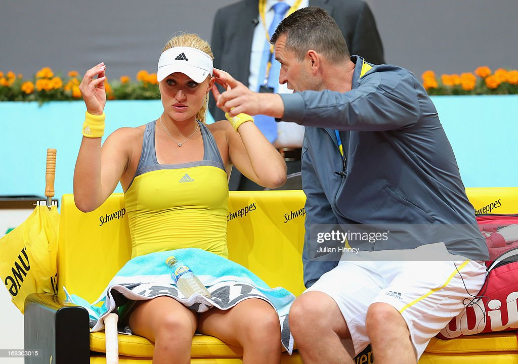 Kristina Mladenovic of France receives advice from father, Dragan Mladenovic against against Maria Kirilenko of Russia during day five of the Mutua Madrid Open tennis tournament at the Caja Magica on May 8, 2013 in Madrid, Spain.