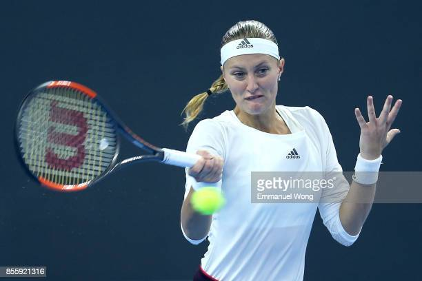 Kristina Mladenovic of France returns a shot against YingYing Duan of China on day one of the 2017 China Open at the China National Tennis Centre on...