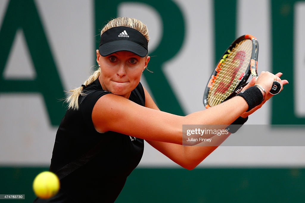 <a gi-track='captionPersonalityLinkClicked' href=/galleries/search?phrase=Kristina+Mladenovic&family=editorial&specificpeople=4835181 ng-click='$event.stopPropagation()'>Kristina Mladenovic</a> of France returns a shot during her women's singles match against Eugenie Bouchard of Canada on day three of the 2015 French Open at Roland Garros on May 26, 2015 in Paris, France.