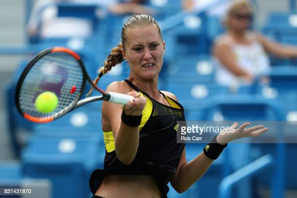 Kristina Mladenovic of France returns a shot to Daria Gavrilova of Australia during the Western and Southern Open on August 14 2017 in Mason Ohio