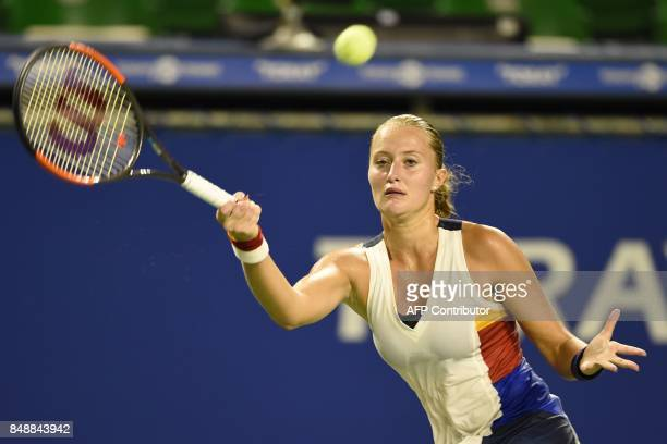 Kristina Mladenovic of France returns a shot to Wang Qiang of China during their first round match in the Pan Pacific Open tennis tournament in Tokyo...