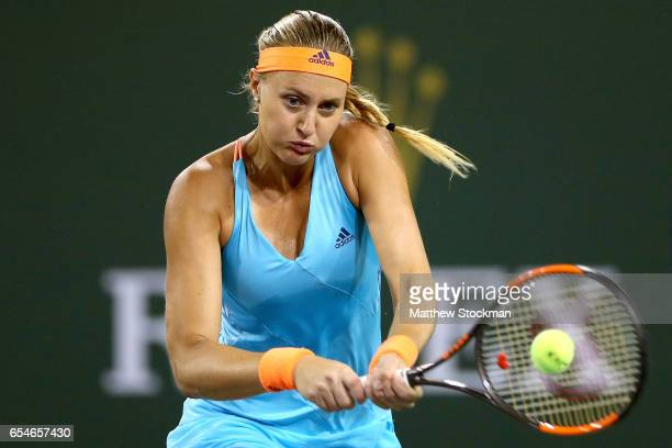 Kristina Mladenovic of France returns ashot to Elena Vesnina of Russia during the semifinals of the BNP Paribas Open at the Indian Wells Tennis...