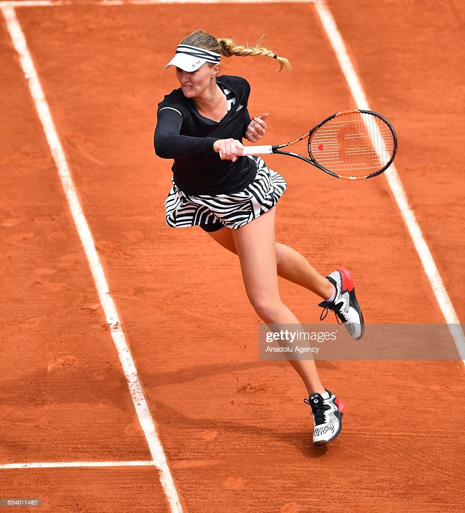 Kristina Mladenovic of France returns the ball during women's single first round match at the French Open tennis tournament at Roland Garros in Paris, France on May 24, 2016.