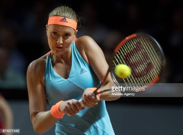 Kristina Mladenovic of France returns the ball to Angelique Kerber of Germany during the Porsche Tennis Grand Prix at Porsche Arena in Stuttgart...