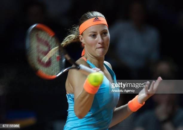 Kristina Mladenovic of France returns the ball to Laura Siegemund of Germany during the Porsche Tennis Grand Prix at Porsche Arena in Stuttgart...