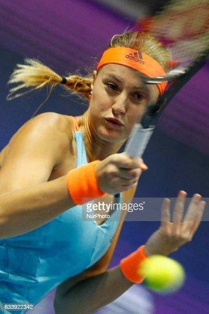 Kristina Mladenovic of France returns the ball to Yulia Putintseva of Kazakhstan during their final match at St Petersburg Ladies Trophy tennis...