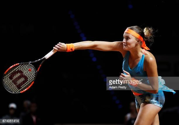 Kristina Mladenovic of France serves during her match against Angelique Kerber of Germany during the Porsche Tennis Grand Prix at Porsche Arena on...