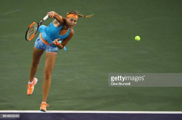 Kristina Mladenovic of France serves during her straight sets defeat by Elena Vesnina of Russia in their semi final match during day twelve of the...