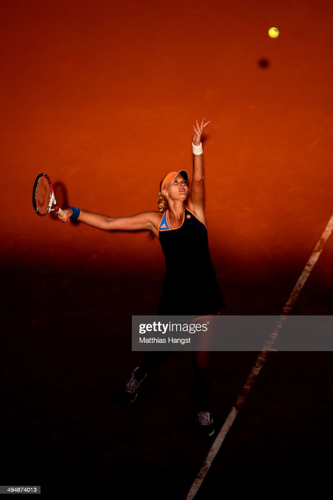 Kristina Mladenovic of France serves during her women's singles match against Andrea Petkovic of Germany on day seven of the French Open at Roland Garros on May 31, 2014 in Paris, France.