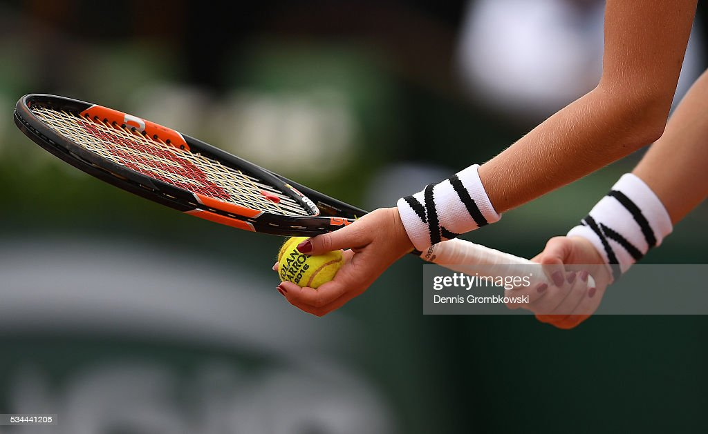 Kristina Mladenovic of France serves during the Ladies Singles second round match against Timea Babos of Hungary on day five of the 2016 French Open at Roland Garros on May 26, 2016 in Paris, France.